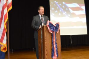 Jeff Simons speaking at Green Meadow Veterans Day assembly