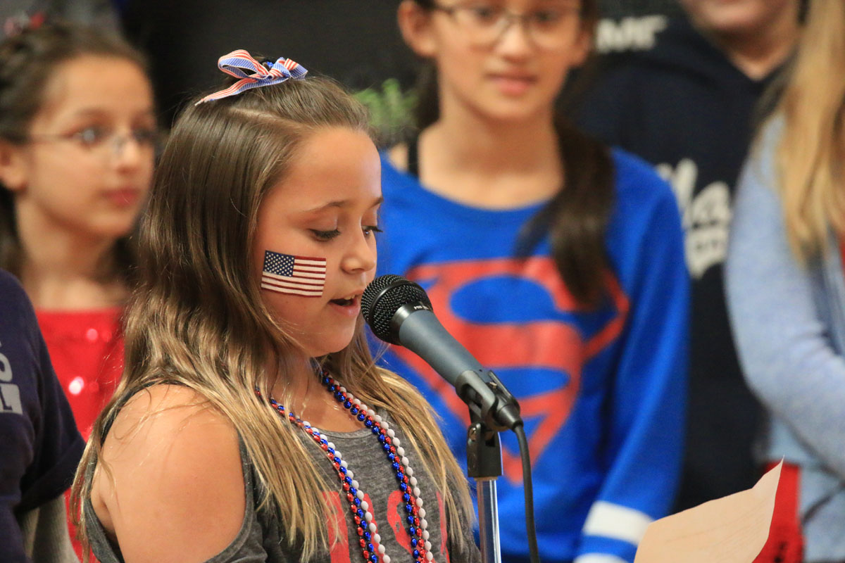 Student speaking at DPS Veterans Day assembly