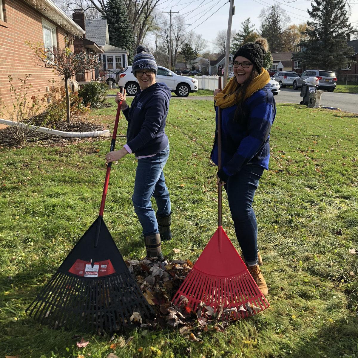 Teachers raking leaves