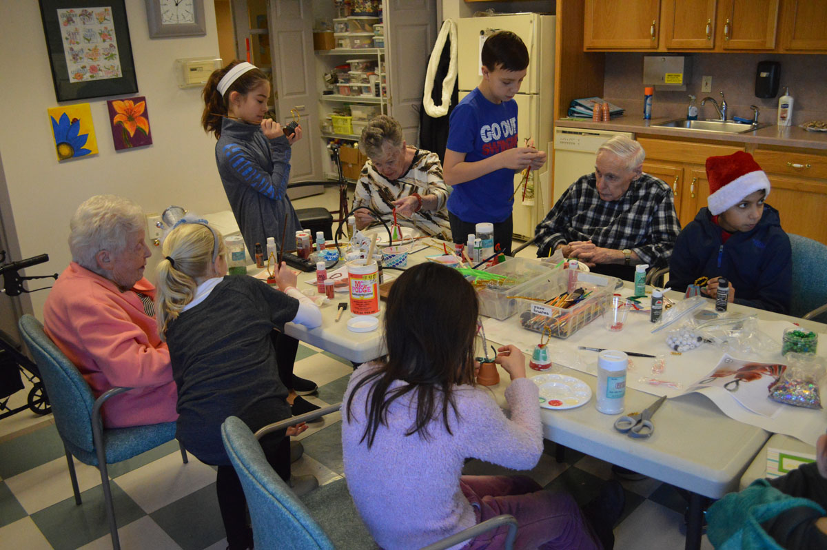 Students and seniors make Christmas ornaments together