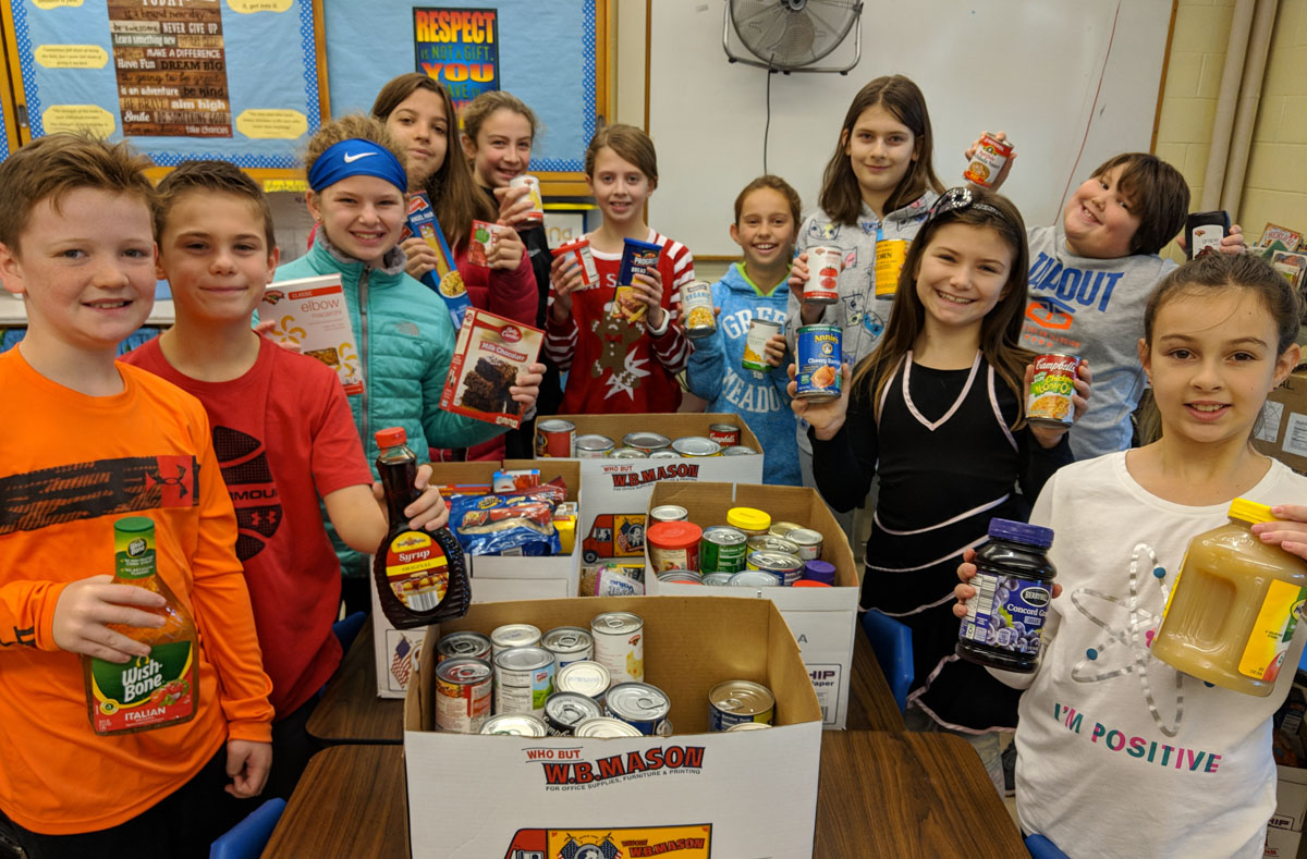 Green Meadow Student Council with food drive items