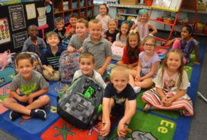 Kindergarten students sitting on a rug