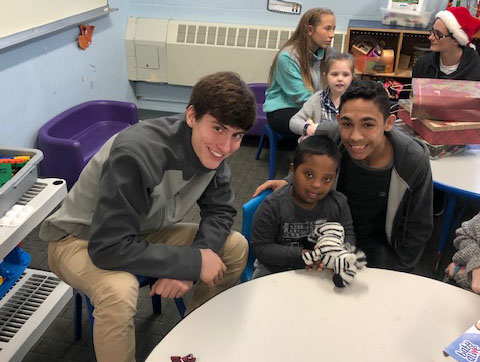Students visit with local preschool children