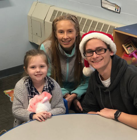 Students visit with local preschool children