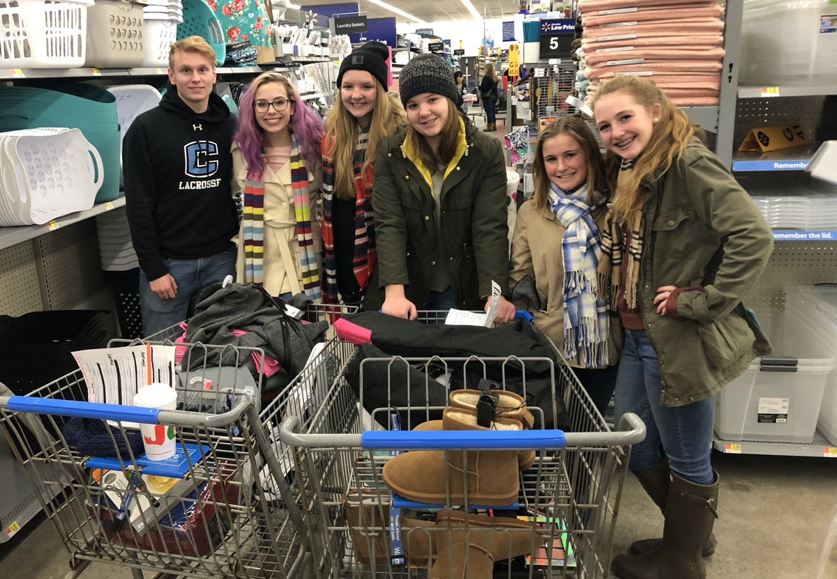 Students shopping for adopt-a-families