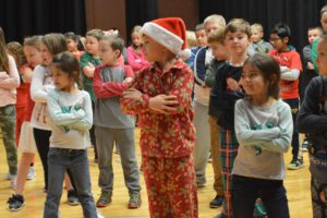 Students dancing at Genet holiday assembly