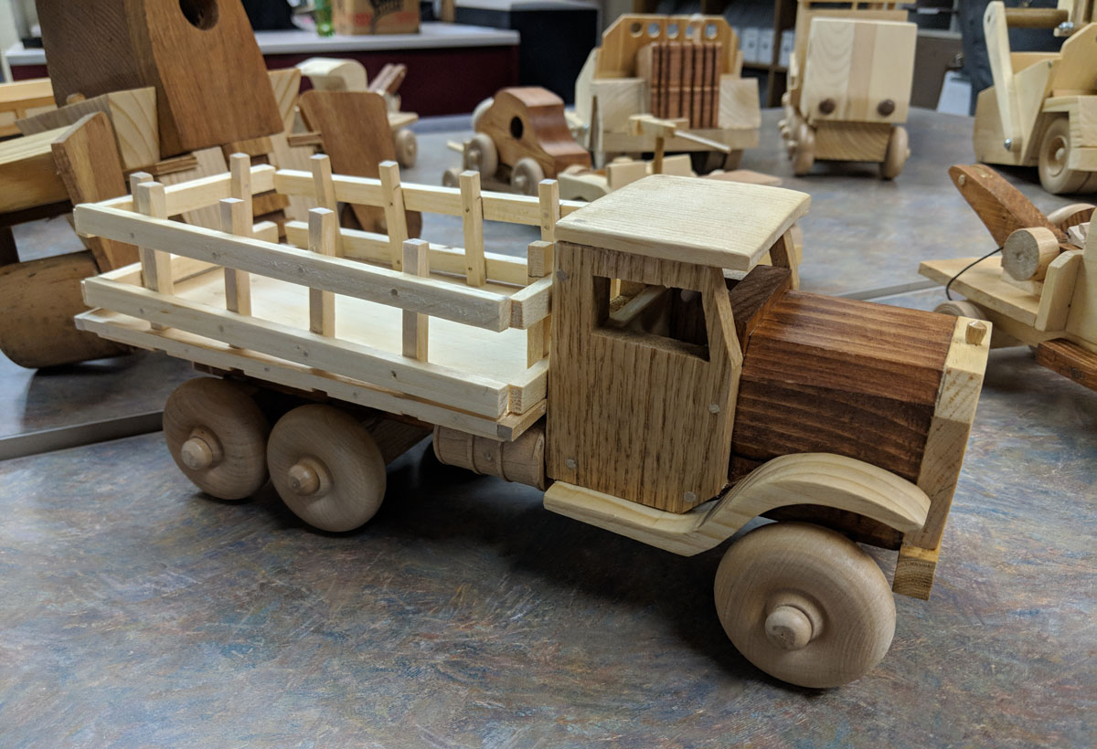 A wooden toy truck