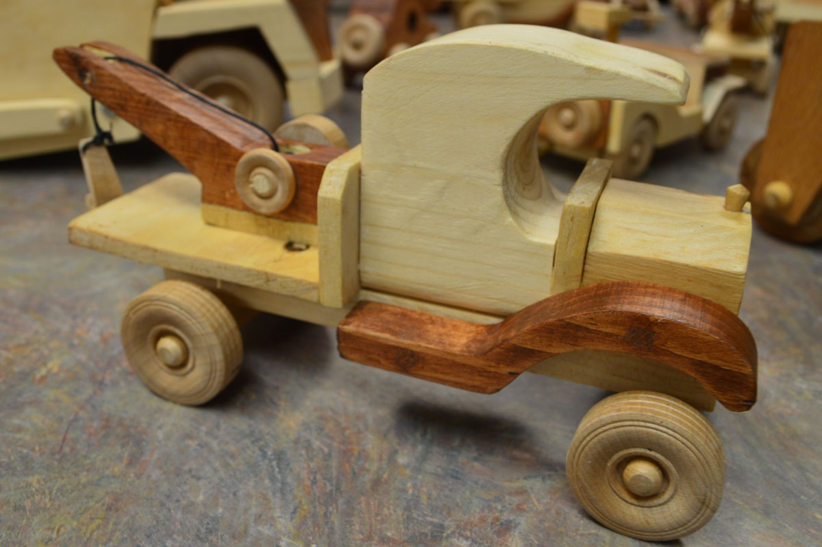 Wooden toy tow truck
