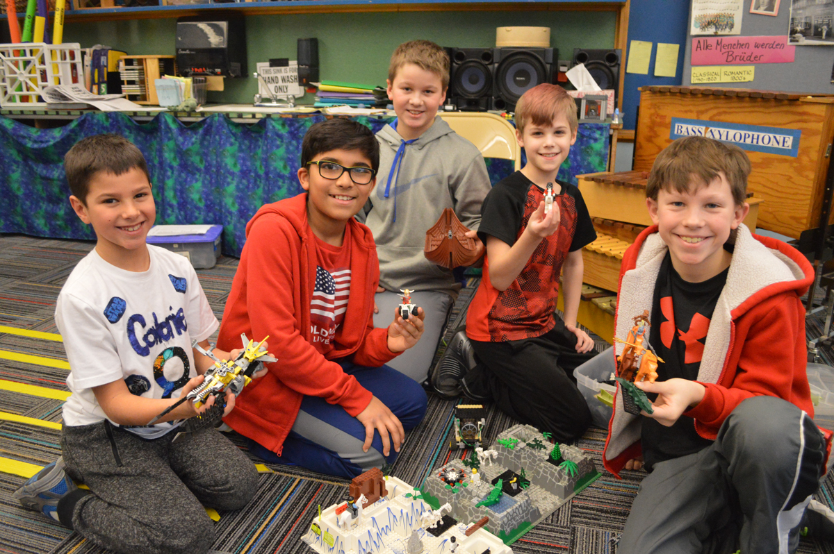 Students playing with Legos after school
