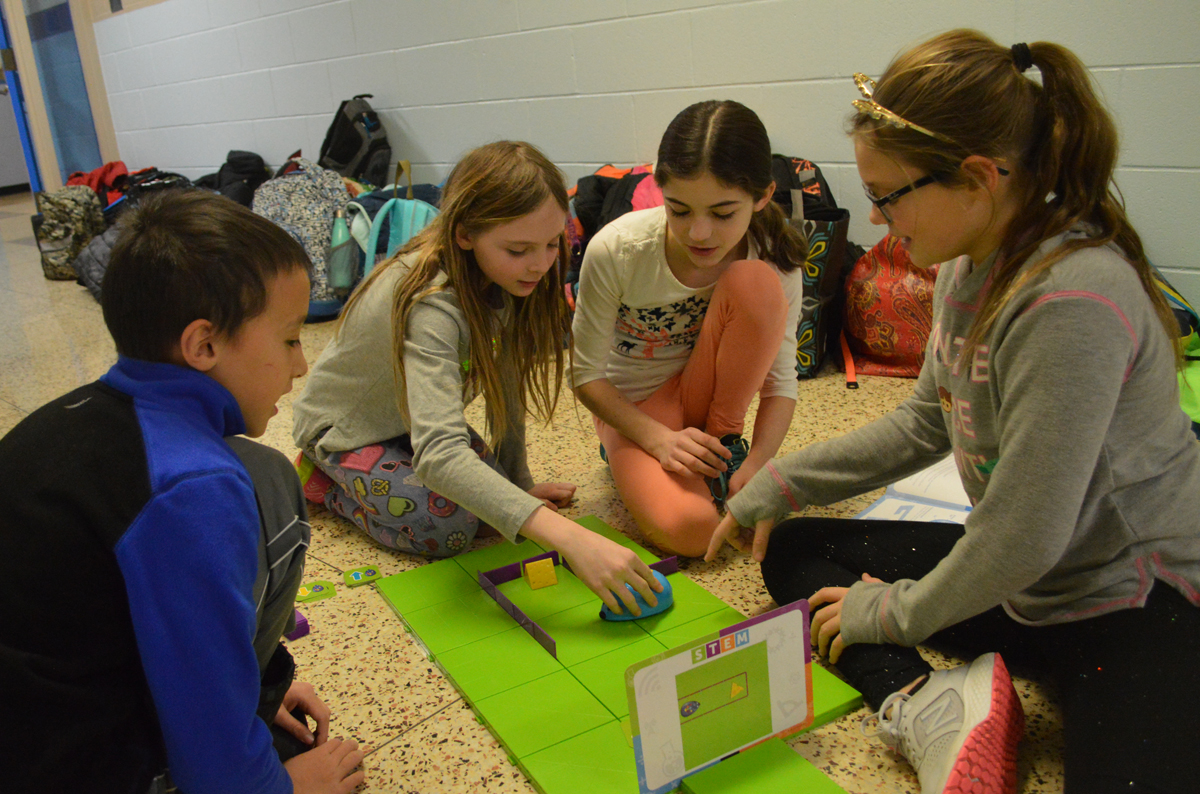 Students working together on coding robots