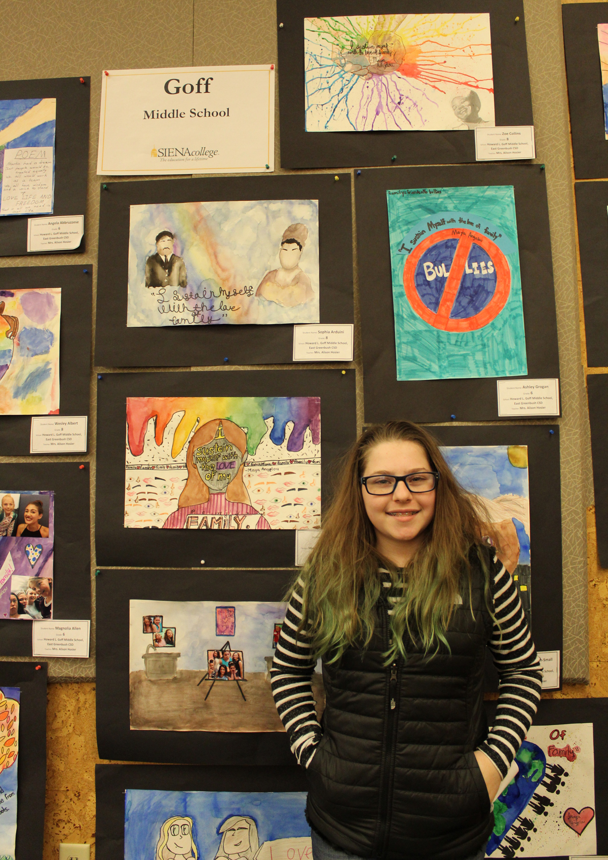 Student with artwork at MLK Art Exhibit