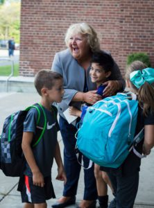 Ana Yeomans hugging a student on the first day of school