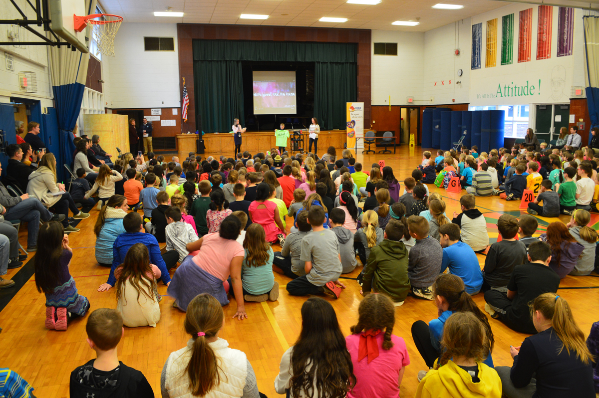 School-wide assembly in the Green Meadow gym