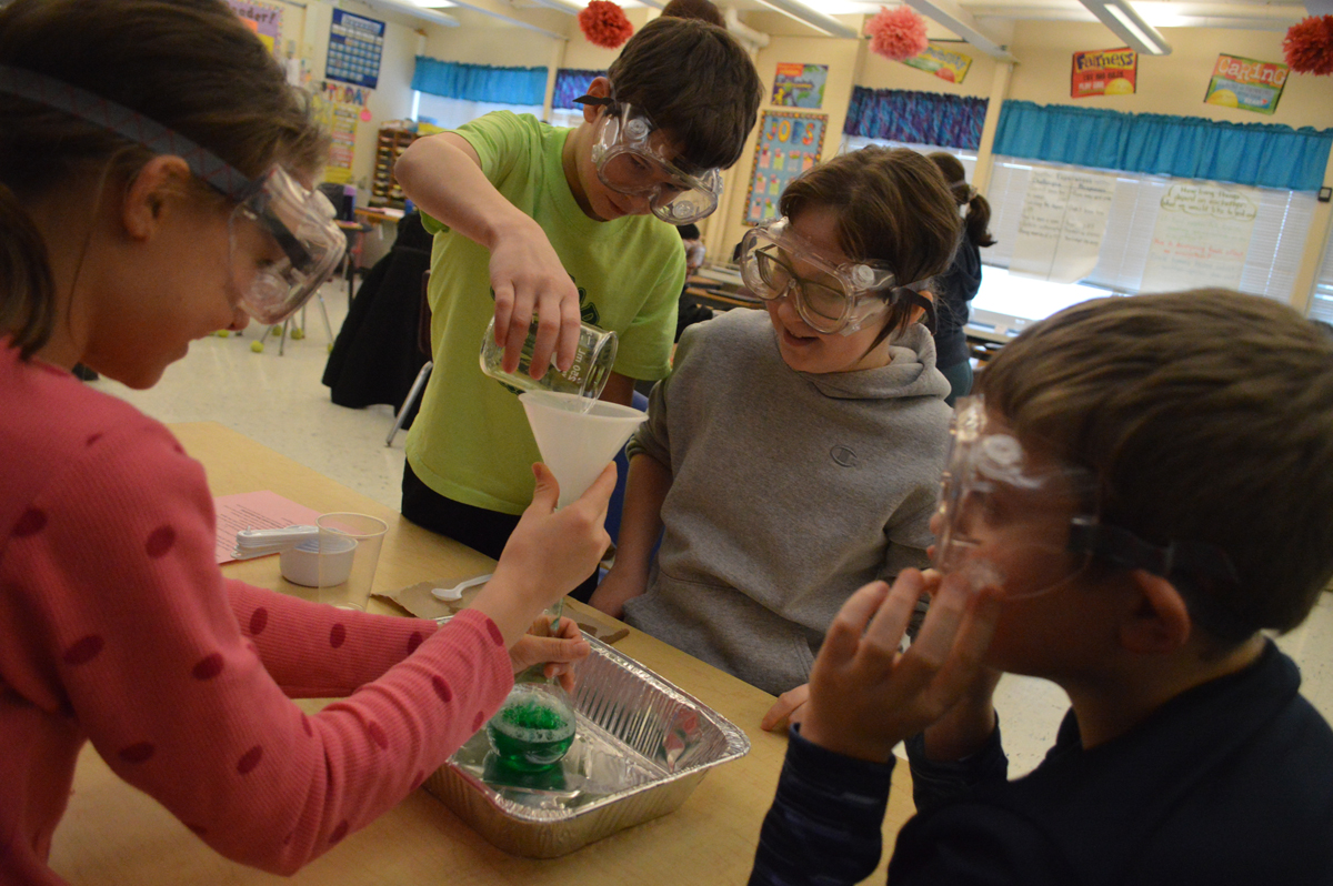 Students conduct chemistry experiment