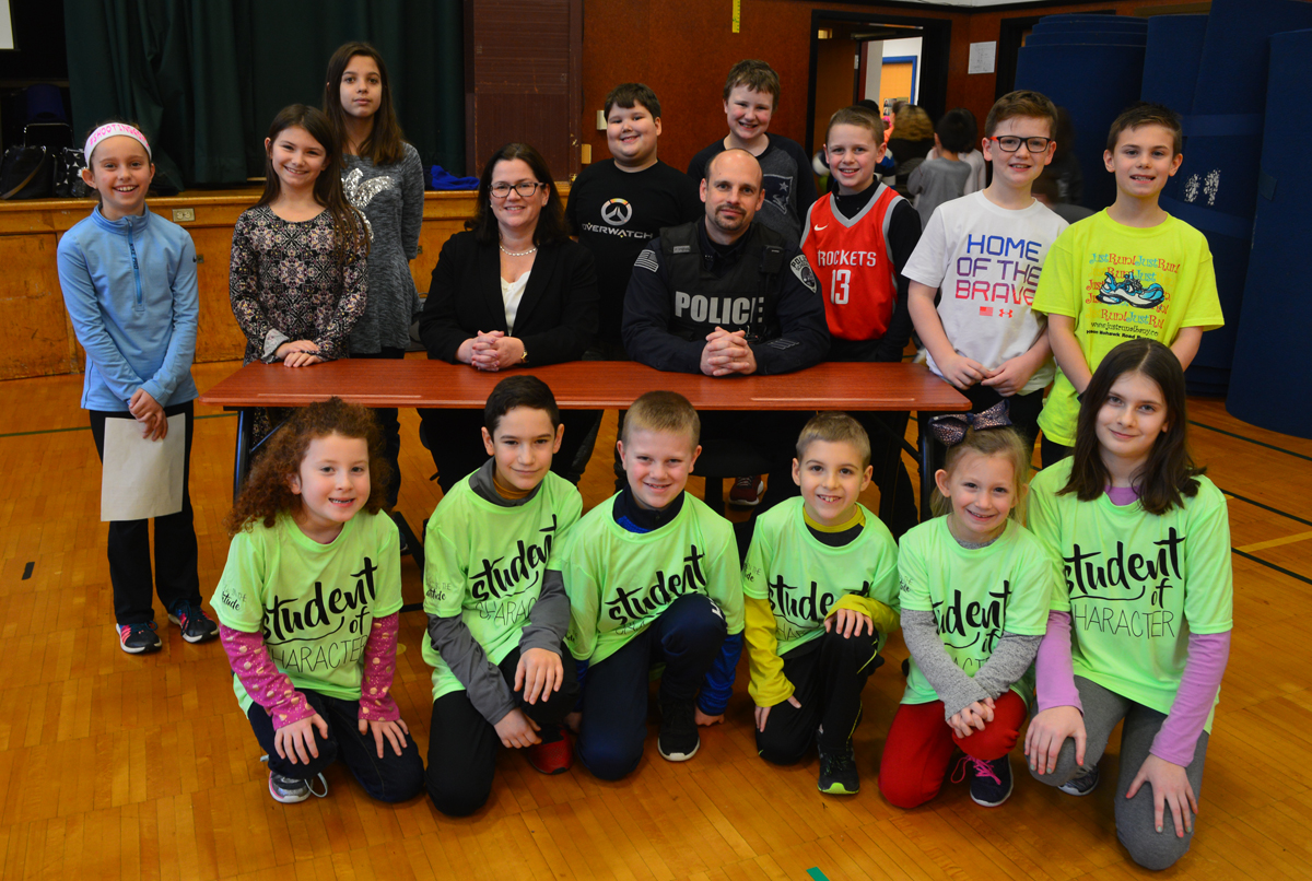 Rensselaer County DA Mary Pat Donnelly and Schodack Police Officer Rich Eckel with students web