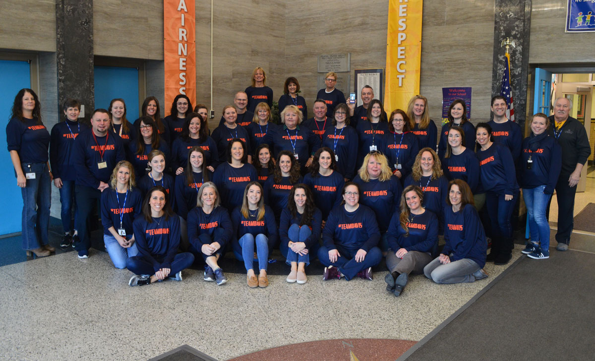 Genet teachers and staff wearing #teamdavis shirts