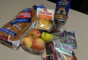 Bread, apples and other food items on a table