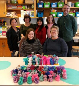 Goff Middle School staff display the mini beanies that will be mailed out