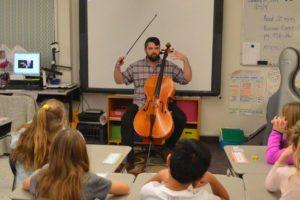 Cellist from Bridge Arts Ensemble program