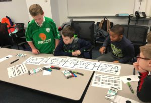Coding Club students work with Ozobots