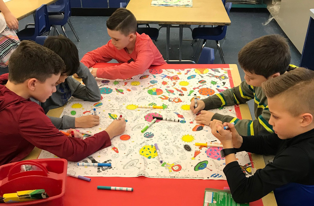 Students color pillowcases