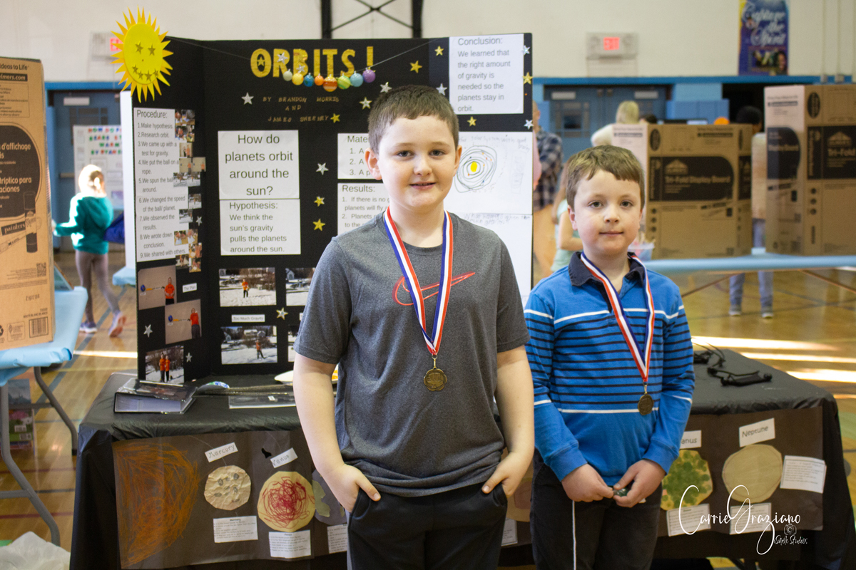 Students wearing medals at STEM Fair