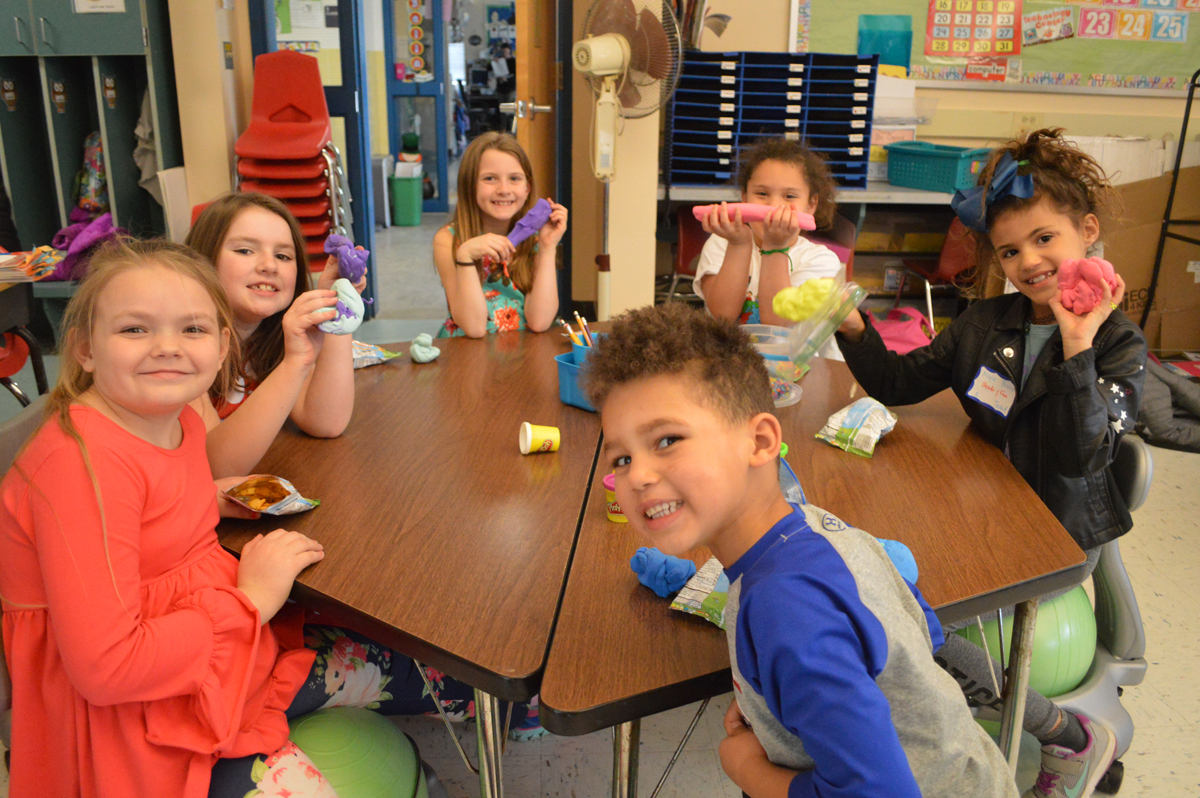 Students play with Play-Doh at after school enrichment