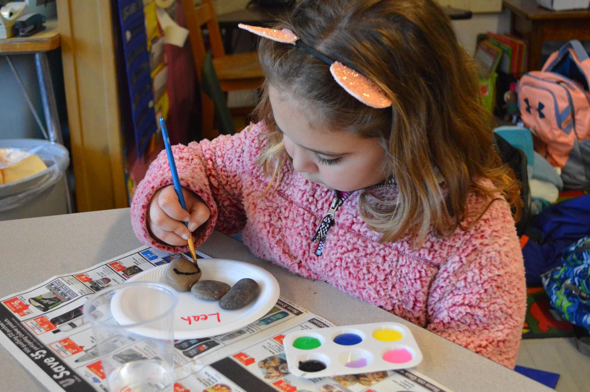 Student paints a kindness rock