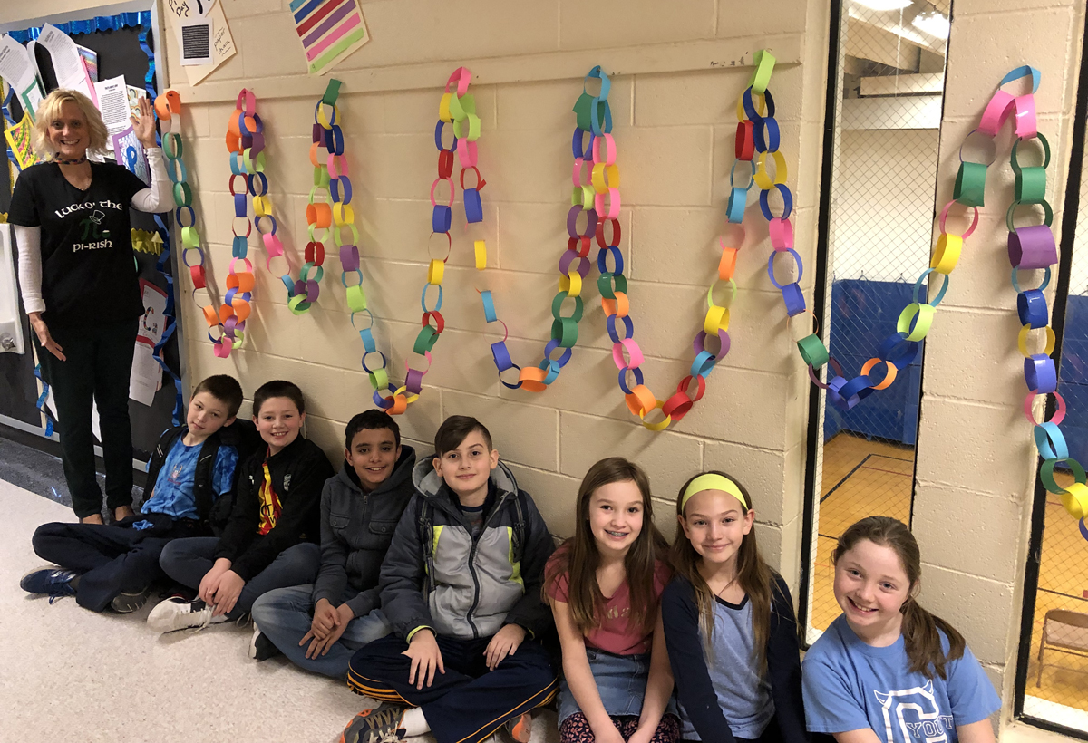 Red Mill students in front of Pi Day display