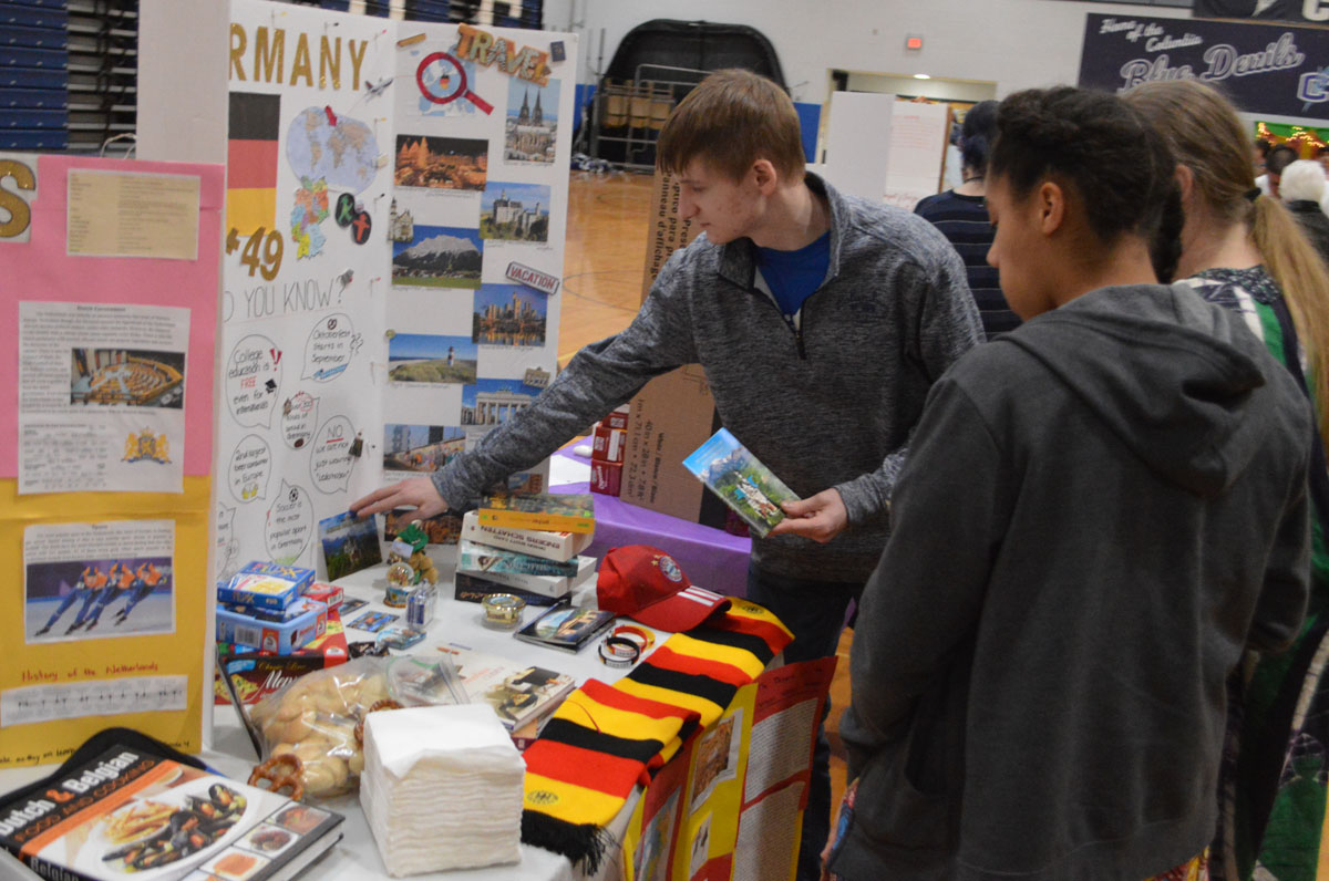 Students look at Multicultural Fair display