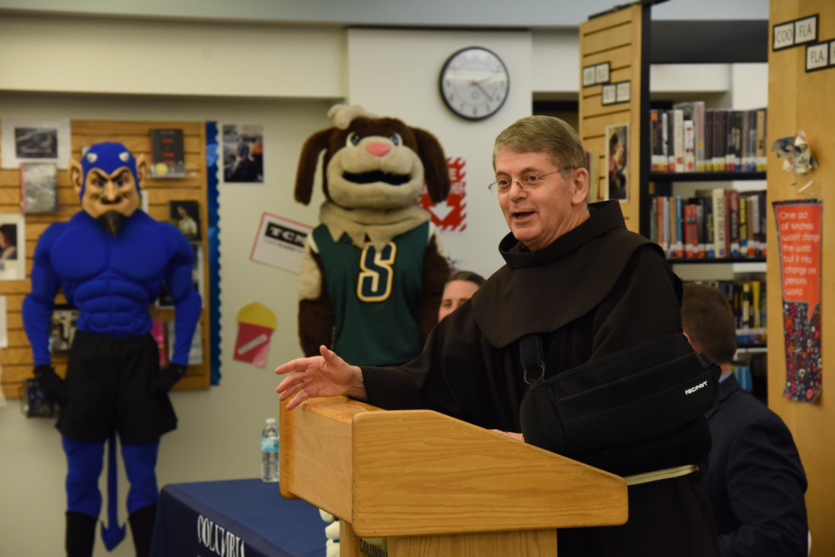 Siena President Br. Ed Coughlin, O.F.M., speaking at event
