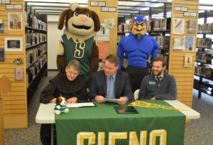 Br. Ed Coughlin, O.F.M., signs partnership with Columbia High School