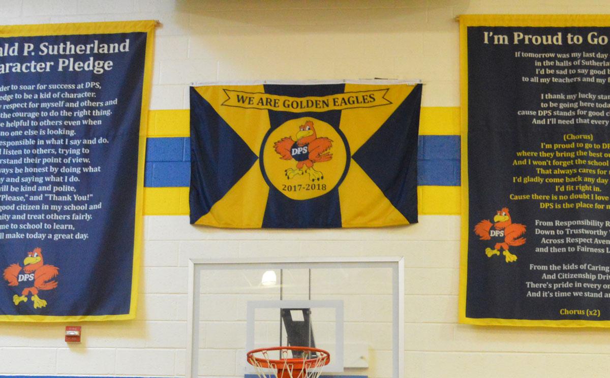 DPS 2017-18 school flag displayed in school gym