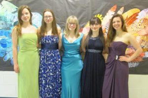 Students wearing prom dresses