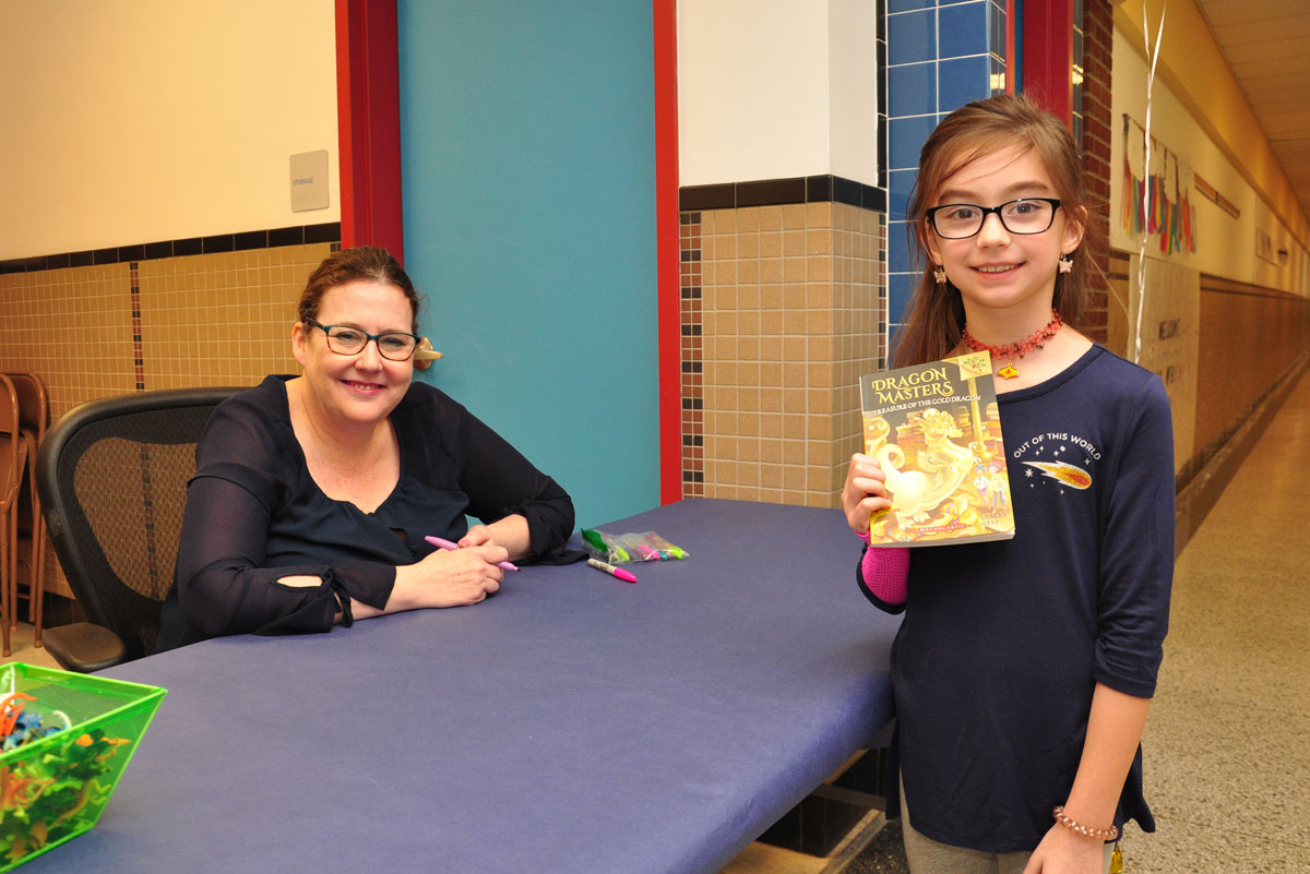Tracey West signs book for student