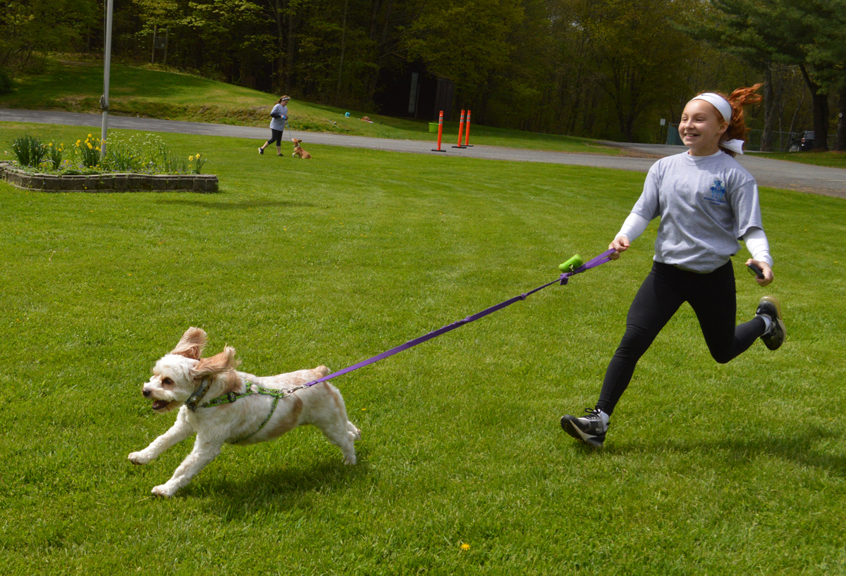Student runs with dog