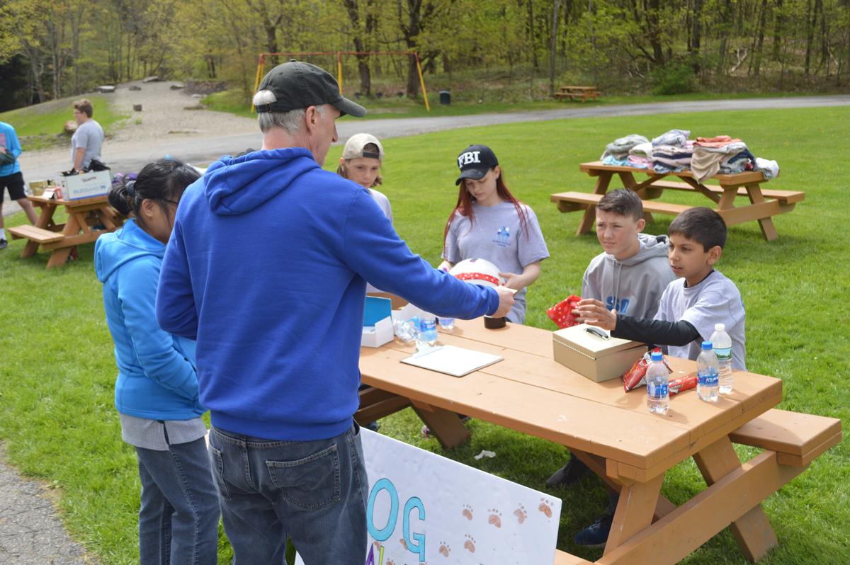 Students volunteer at Dog Wash and Walk fundraiser