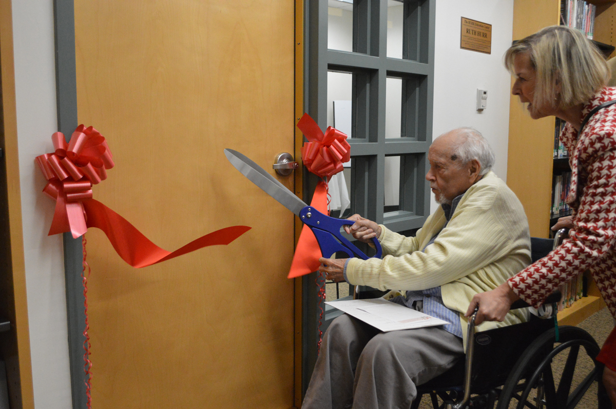 Bob King cuts ribbon at Hurr Education Center dedication