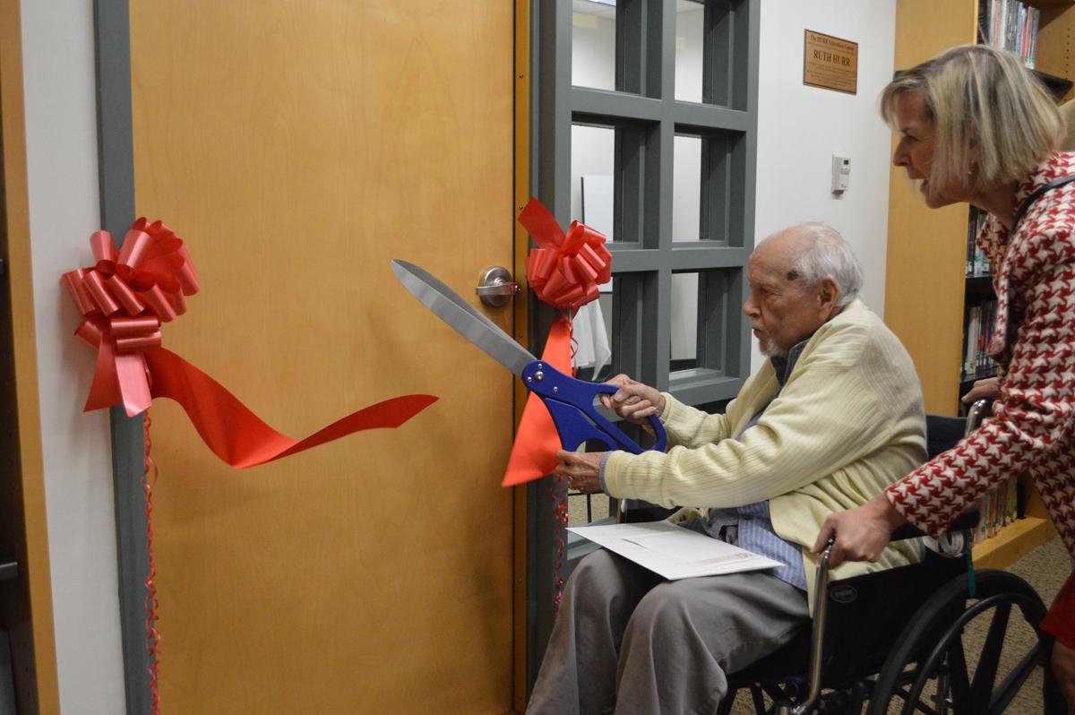 Bob King cuts ribbon at Hurr Education Center dedication