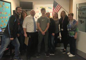 Joseph Bradt with teachers and staff