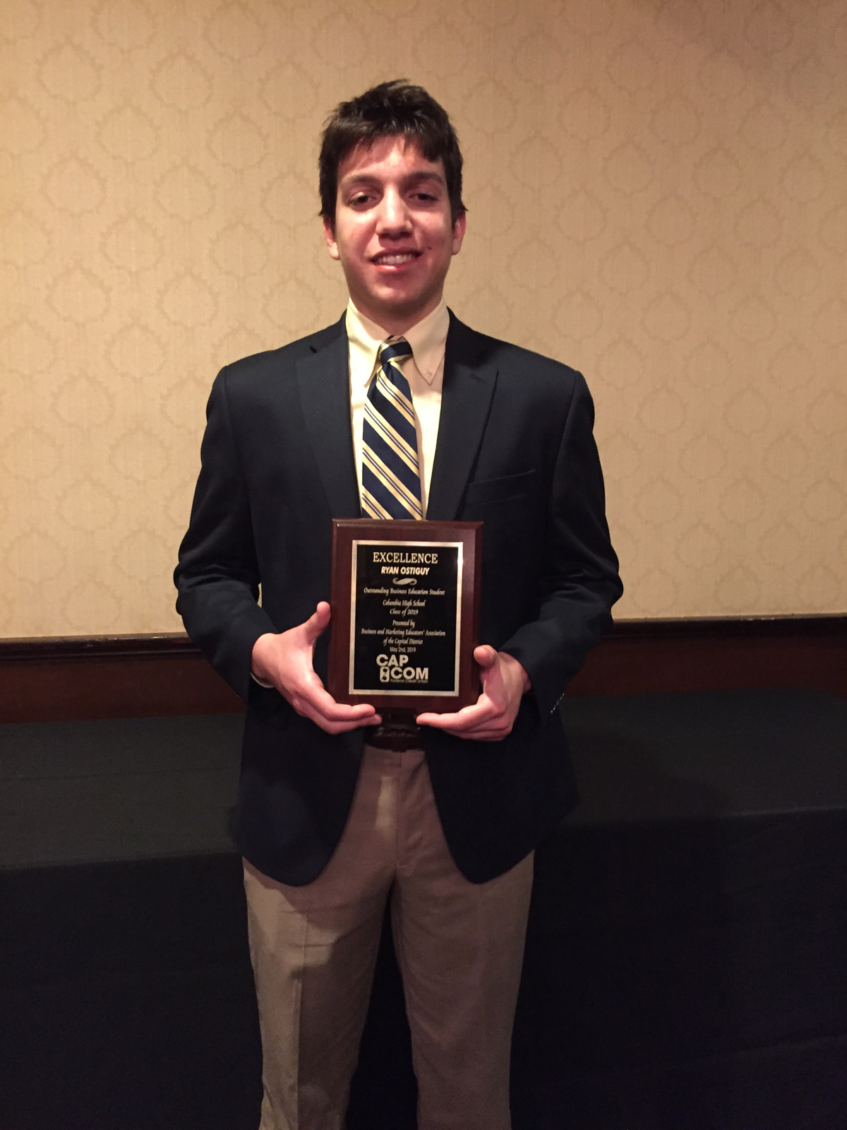 Ryan Ostiguy receives Business Student of the Year award