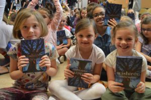 Students holding their new books