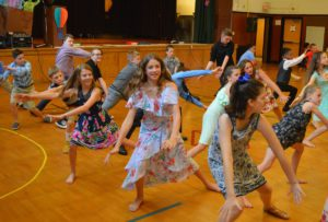 Students dancing at the Green Meadow Moving Up Ceremony