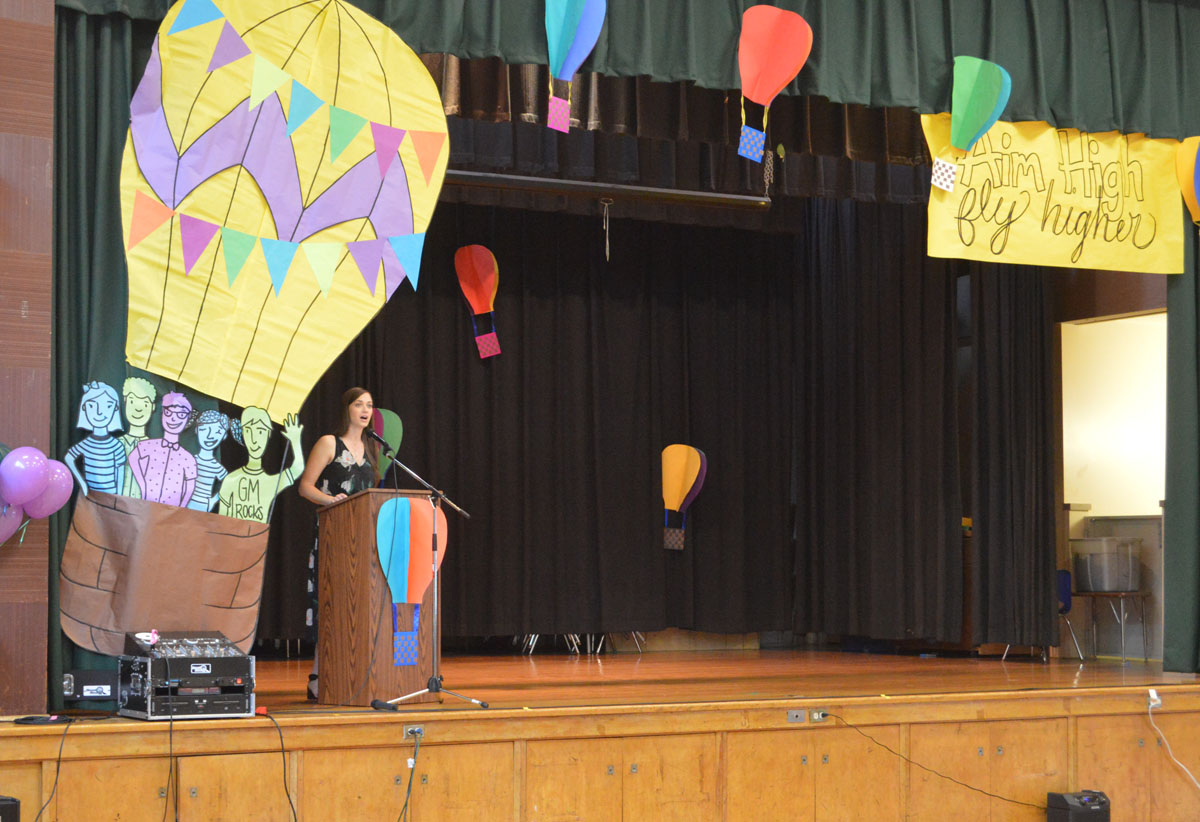 Mrs. Reinstein addressing students and families at the Moving Up Ceremony