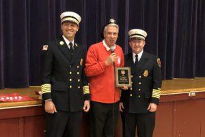 Principal Caporta receives plaque