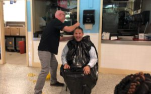 Principal Grignon having his head shaved by English teacher Sean Crall