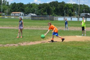 Students playing kickball web