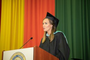 English Teacher Emily Shatraw delivering keynote address at graduation
