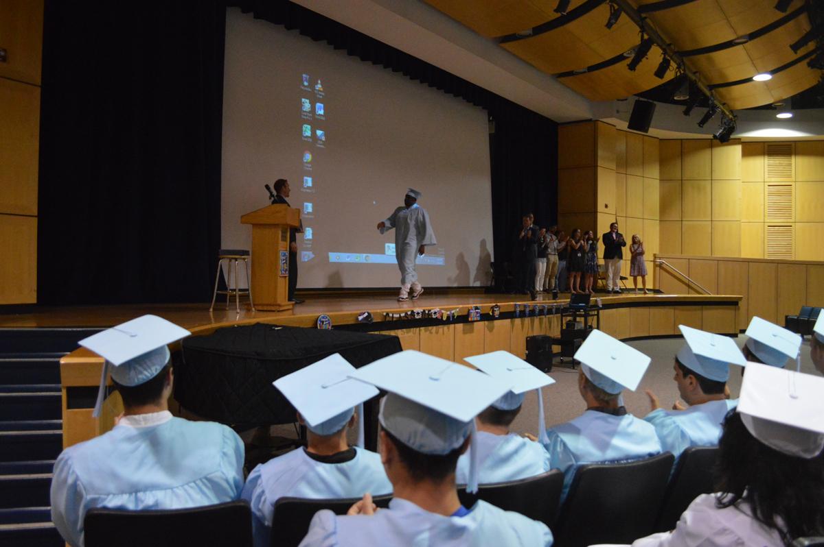 Graduate walks across stage