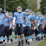 Columbia football players walk to field